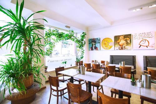 Restaurant ou autre lieu de restauration dans l'établissement Pension Peters – Das andere Hotel
