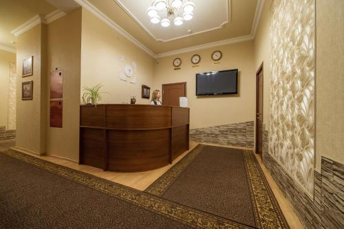 The lobby or reception area at Hotel Lion