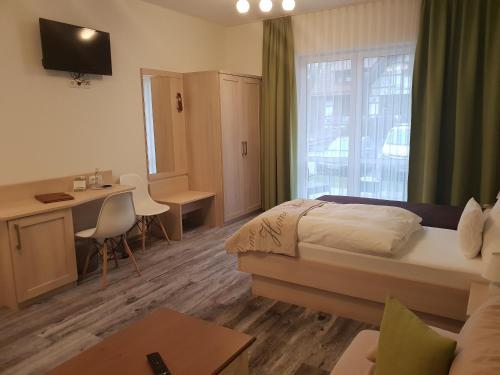 TV/Unterhaltungsangebot in der Unterkunft Neue Mühle Hotel & Restaurant