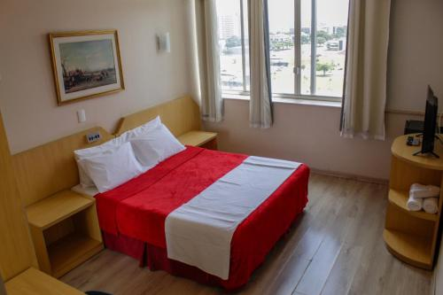 A bed or beds in a room at Airam Brasília Hotel