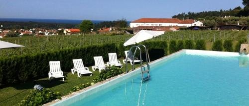 A view of the pool at Quinta do Paco d'Anha or nearby