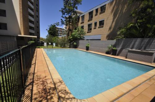 The swimming pool at or near Neutral Bay Self Contained Studio Apartments