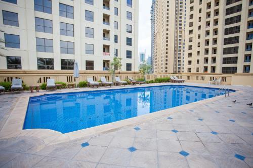 The swimming pool at or near Rimal 4 Marina view studio