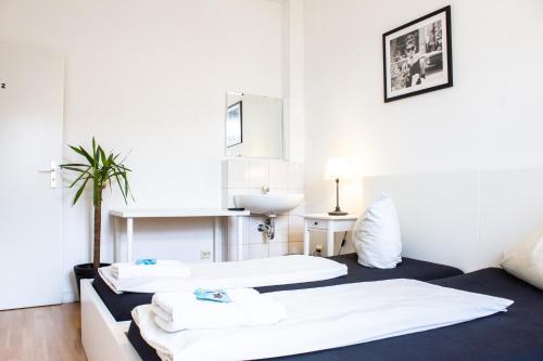 Ein Bett oder Betten in einem Zimmer der Unterkunft Shiva's CitySleep