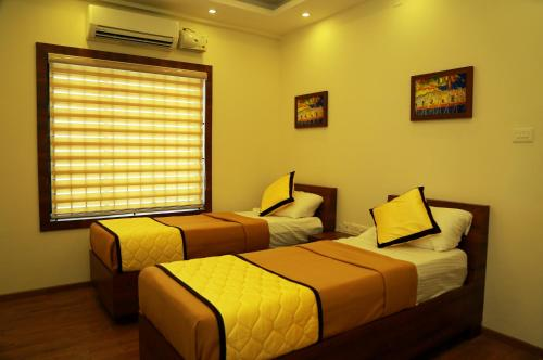 A bed or beds in a room at Sree Janardhana Residency