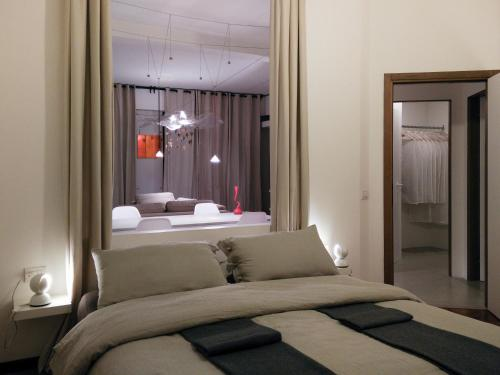 A bed or beds in a room at Un Open Space in Centro Storico