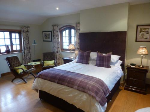 A bed or beds in a room at Manor House Farm
