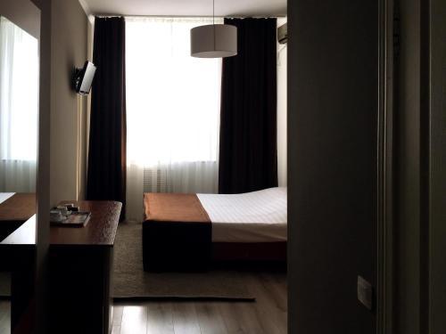 Кровать или кровати в номере Гостиница Вираж