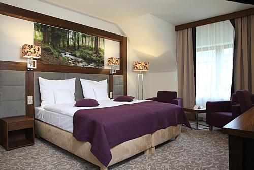 Łóżko lub łóżka w pokoju w obiekcie Hotel Mercure Krynica Zdrój Resort&Spa