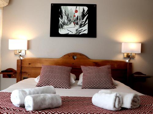 Un ou plusieurs lits dans un hébergement de l'établissement The Originals Annemasse Sud - Porte de Genève