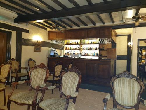 The lounge or bar area at Albright Hussey Manor Hotel