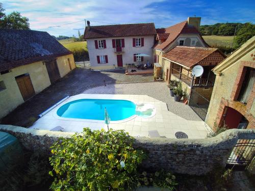 A view of the pool at Maison Lajus or nearby