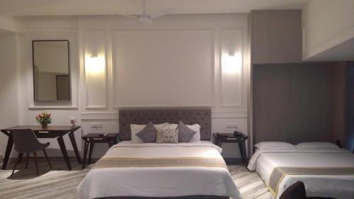 En eller flere senge i et værelse på Sinclairs Bayview