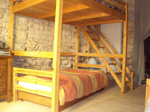 A bunk bed or bunk beds in a room at Entre lune et Soleil