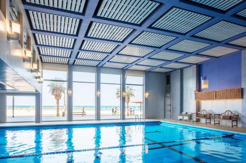 The swimming pool at or near Renaissance Tel Aviv Hotel
