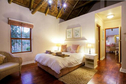 A bed or beds in a room at Hogsback Arminel Hotel