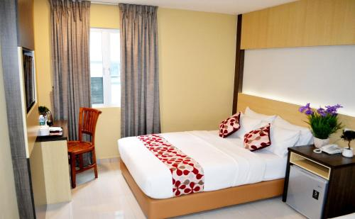 A bed or beds in a room at City Central Hotel