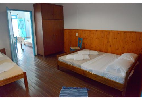 A bed or beds in a room at On the Waves of Klima