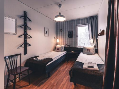 A bed or beds in a room at Åre Bed & Breakfast