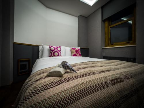 A bed or beds in a room at GalataCo Hotel