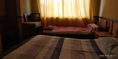A bed or beds in a room at Hostal Will's