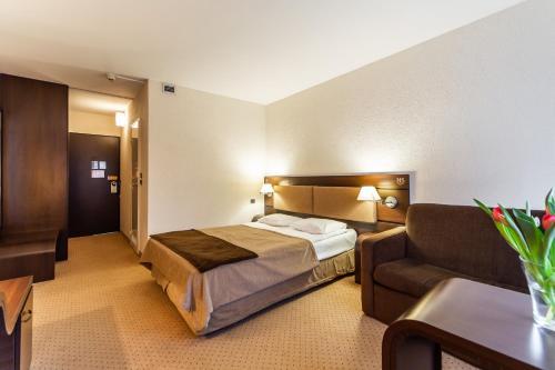 Łóżko lub łóżka w pokoju w obiekcie Hotel Solny