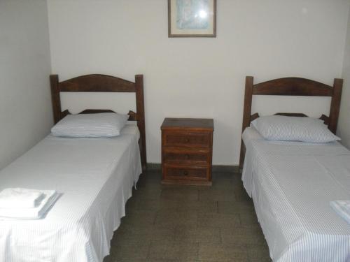 Кровать или кровати в номере Hotel Lund