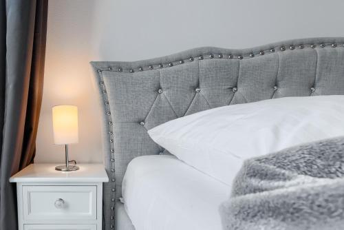 Ein Bett oder Betten in einem Zimmer der Unterkunft Apartament 111 - Apartamenty No.1