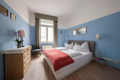 Postel nebo postele na pokoji v ubytování Mondial Appartement Hotel