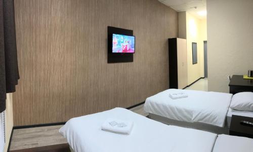 Кровать или кровати в номере Murmansk Discovery - Hotel Kompas