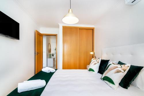 A bed or beds in a room at WHome | Casino Premium Apartment