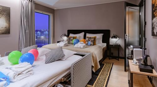 A bed or beds in a room at Clarion Hotel Aviapolis