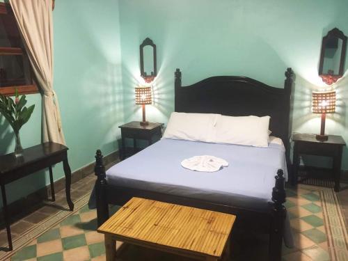 Cama o camas de una habitación en Hotel La Polvora