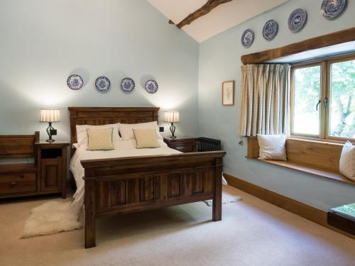 A bed or beds in a room at The Wayside and Whisky Barn