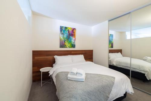 A bed or beds in a room at Canvas Suites on Russell Place