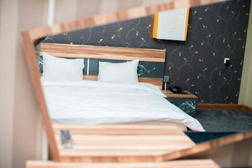 Cama ou camas em um quarto em Marsel Hotel