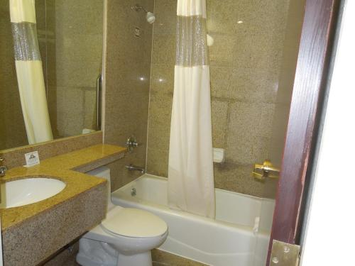 A bathroom at Days Inn by Wyndham Jamaica / JFK Airport