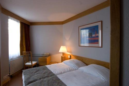 Un ou plusieurs lits dans un hébergement de l'établissement Inter-Résidences Paris XV