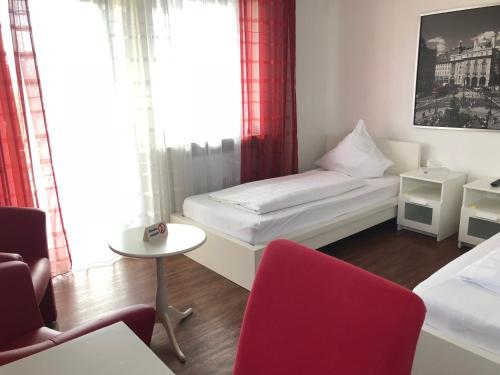 Ein Bett oder Betten in einem Zimmer der Unterkunft Hotel Alka