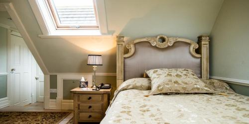 A bed or beds in a room at Berwick Lodge