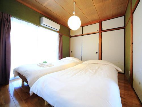 Kamon Inn Kotobuki カモンイン 寿にあるベッド