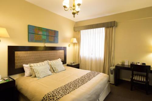 A bed or beds in a room at Costa del Sol Wyndham Cajamarca