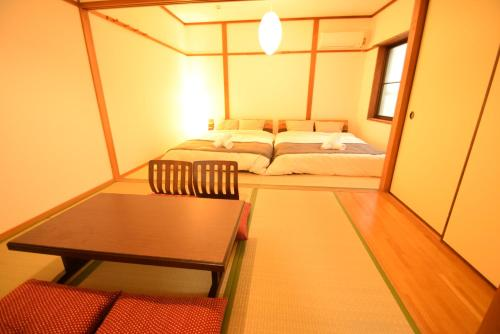 A bed or beds in a room at Color Ebie