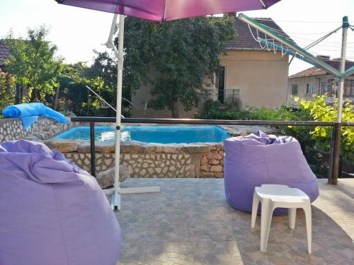 The swimming pool at or near Guest House Bedrock