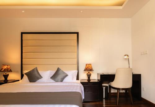 A bed or beds in a room at Lavonca Boutique Hotel