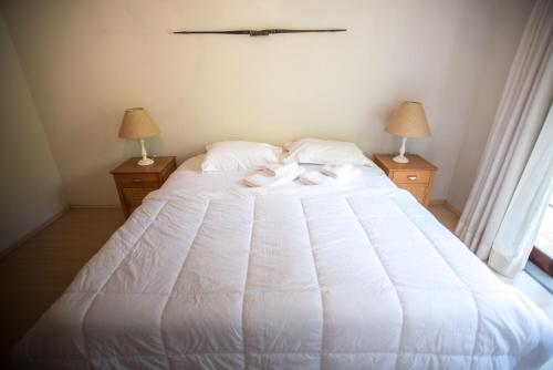 A bed or beds in a room at Bosque Oriri
