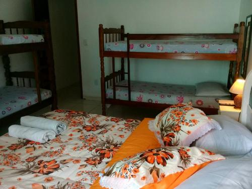A bunk bed or bunk beds in a room at Hostel Kamorim