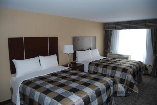 A bed or beds in a room at Days Inn by Wyndham Brampton