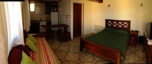 Una cama o camas en una habitación de Cabañas Marias del Sur