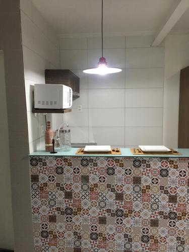 A kitchen or kitchenette at Loft Morada do Porto